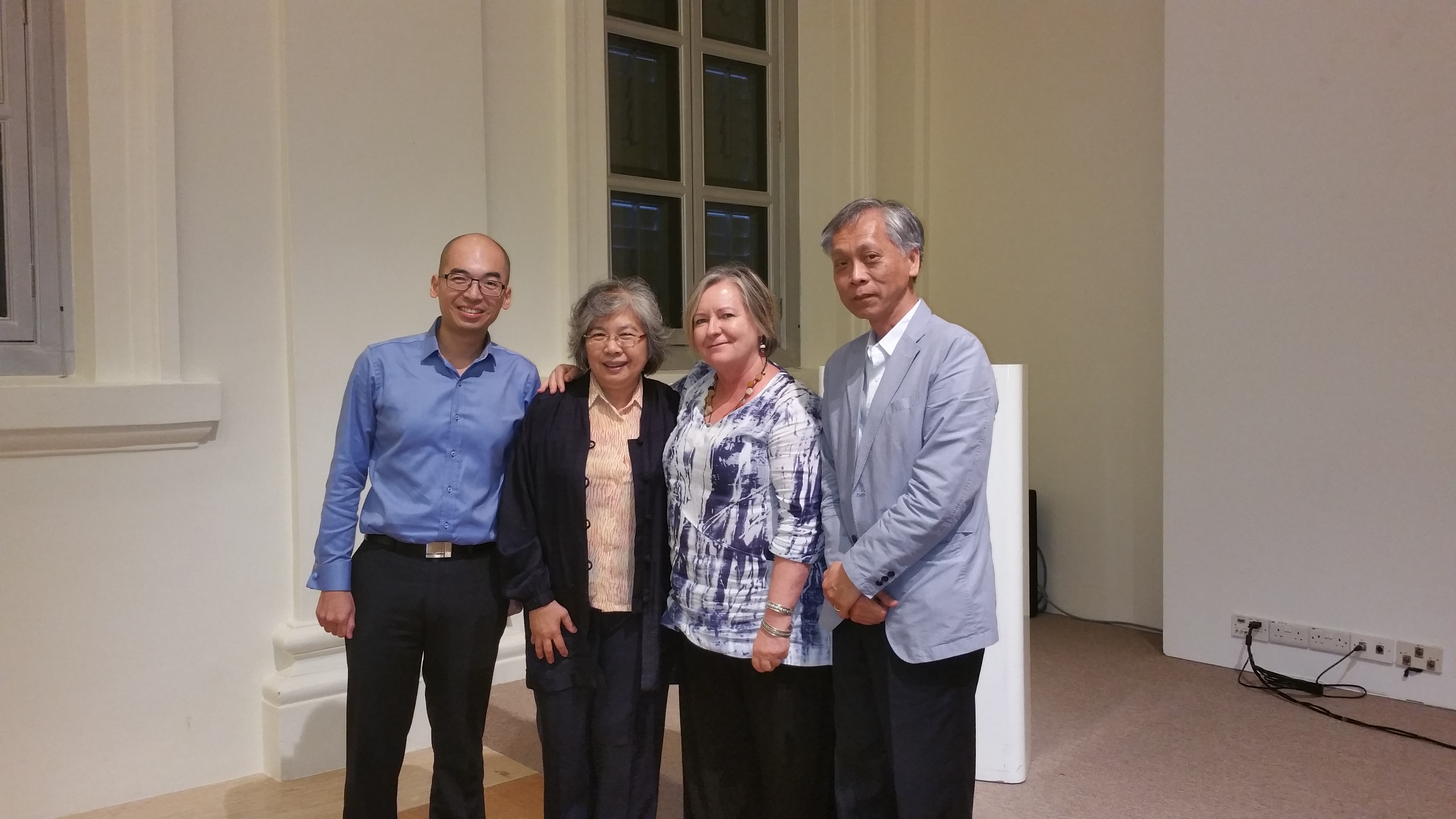 Susan McIntyre-Tamwoy with Singaporean government officers and researchers outside the National Museum of Singapore